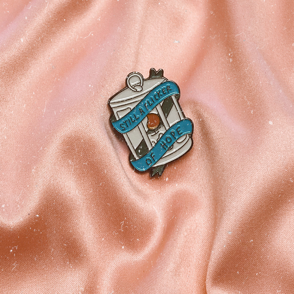 STILL A FLICKER OF HOPE Enamel Pin