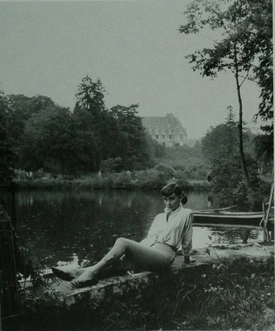 Audrey Hepburn posing by a lake