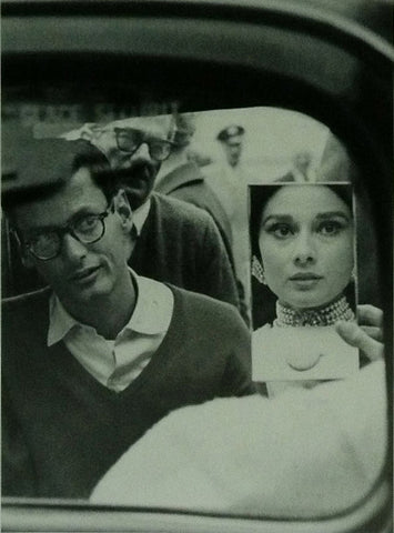 Audrey Hepburn looking in the mirror with Richard Avedon 1959