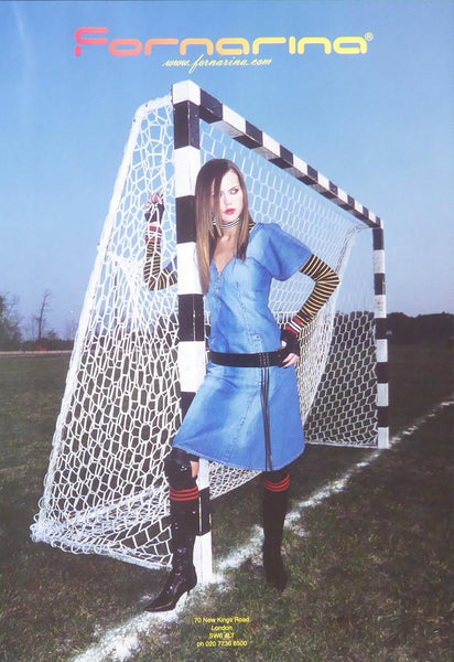 Fornarina Model in blue dress in front of hockey net (Advert)
