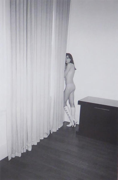 Nude female in white boots by curtains in a room (Glamour) (black & white)