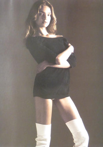 Brunette in black top & white knee length socks (Glamour)