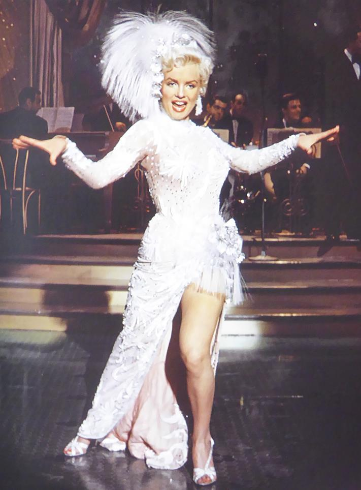 Marilyn in white feathered stage costume
