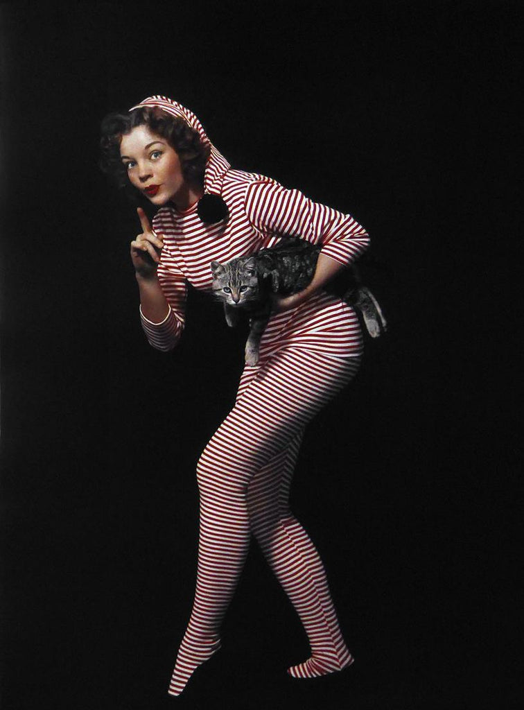 unknown lady in stripes with a cat