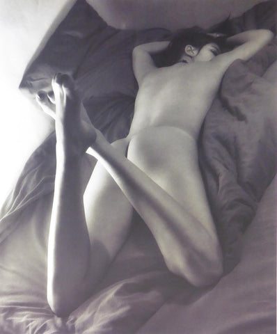 Back view of girl reclinin on a bed ( black & white) (Glamour Shot)