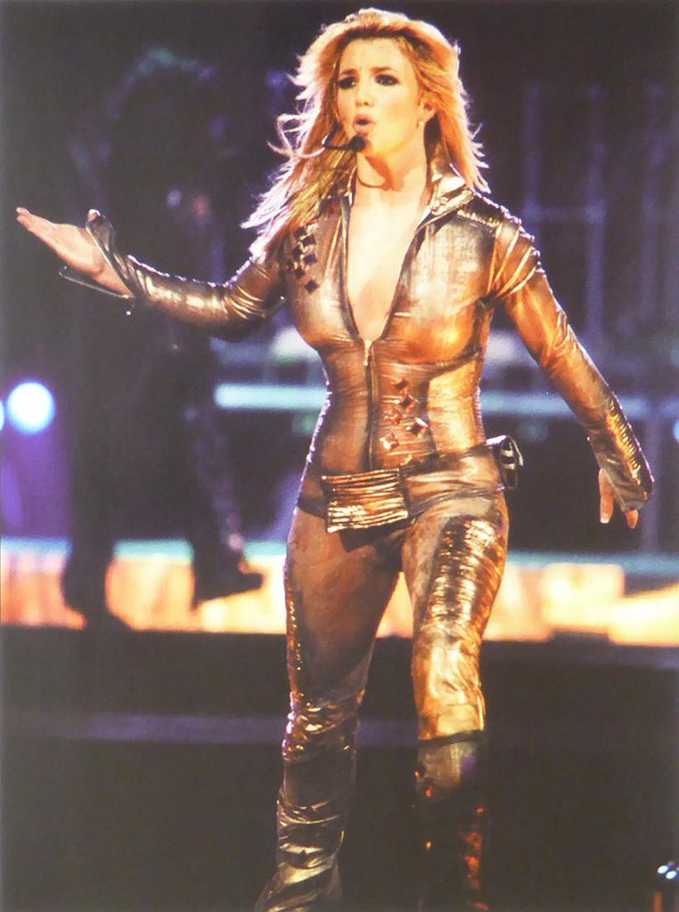 Britney Spears on stage in bronze outfit (full shot)