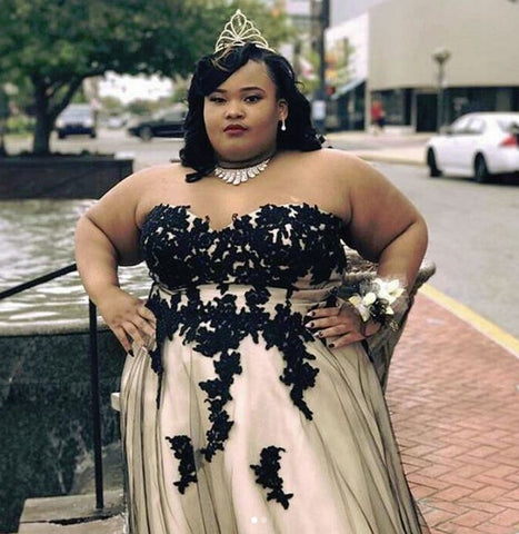 71428dea0 Our ever-popular Bella Ball Gown features black beaded appliques over an A-line  tulle skirt. Prom girls love the lace-up back and natural waist. Plus ...