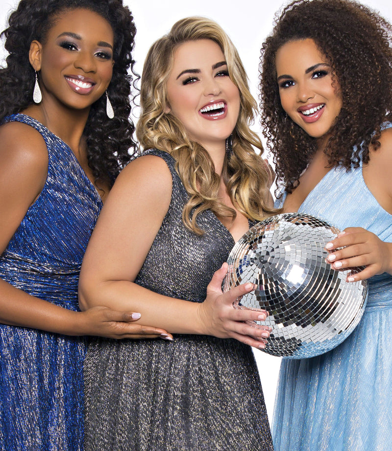plus size special occasion dresses; three girls hugging at prom