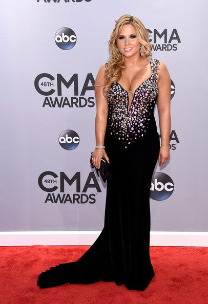 Rachel Holder in black heavily beaded fitted formal gown on red carpet at 2014 CMAs
