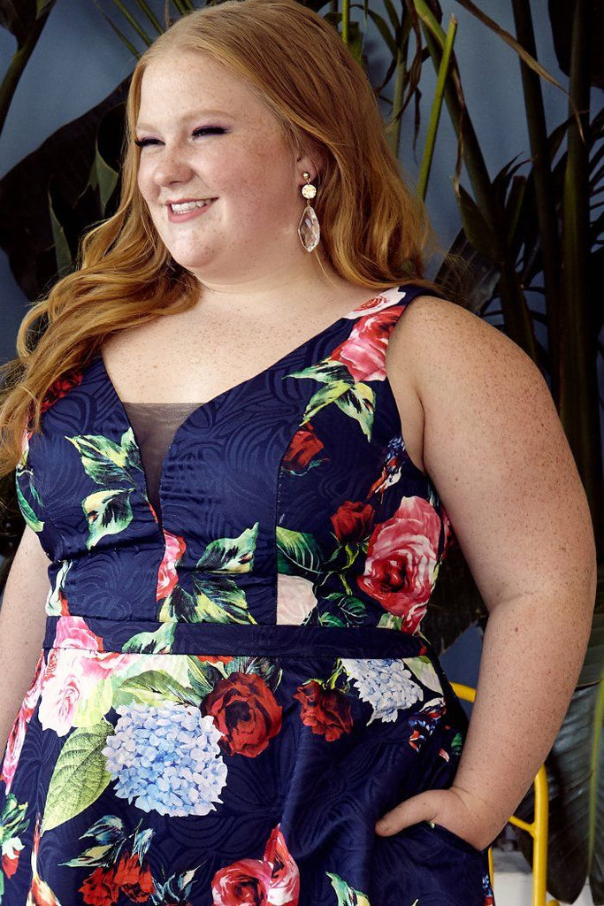 Amanda Lacount wearing CE1806 in all over navy floral; short V-neckline party dress with bra-friendly straps and pockets; photo shoot for PromGirl; plus size floral