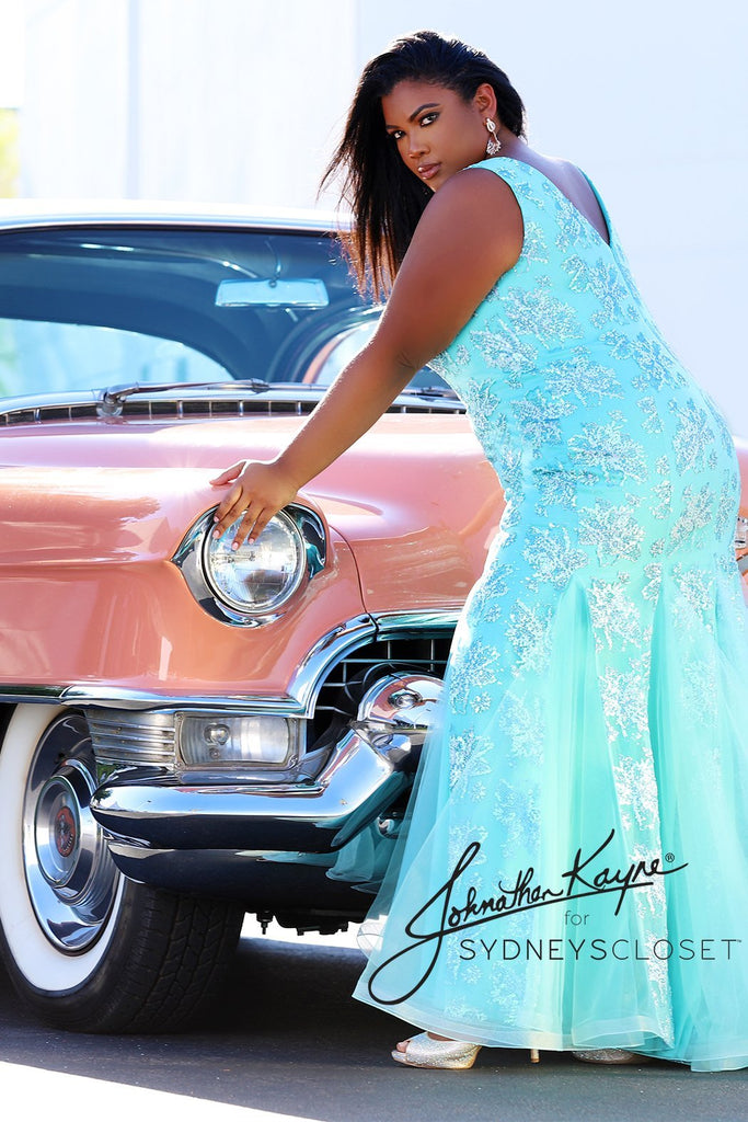 Plus size model on vintage 1955 Cadillac pose in mermaid gown from Johnathan Kayne for Sydney's Closet wearing JK2108 in cyan