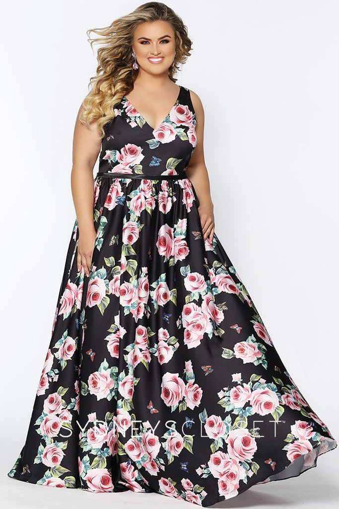 SC7296 black floral plus size evening gown with V-neckline, bra-friendly straps, full flowy skirt in a dramatic floral pattern fabric.