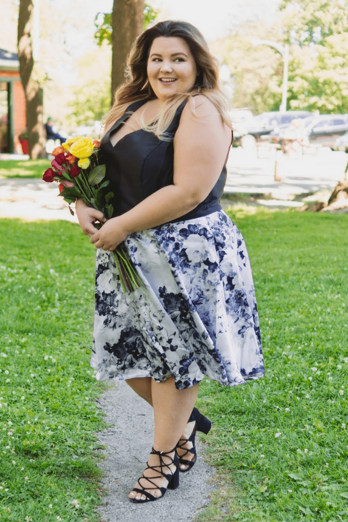 SC8085 black and white plus size party dress with a V-neckline, bra-friendly straps and floral skirt.