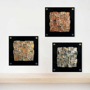 Triptych of gold, silver & bronze geometric abstract paintings on black perspex glass - Interwoven First, Second, Third' by Jayne Leighton Herd