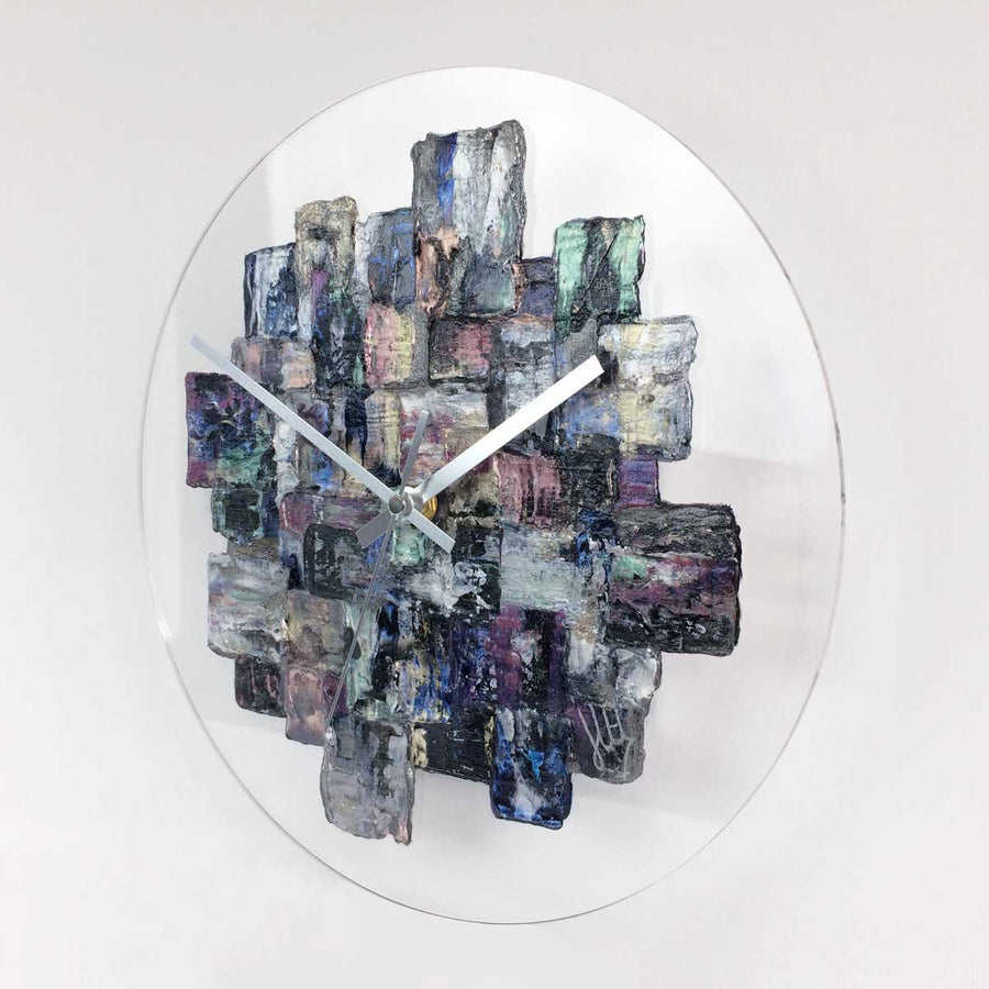 Contemporary metallic designer wall clock on clear glass