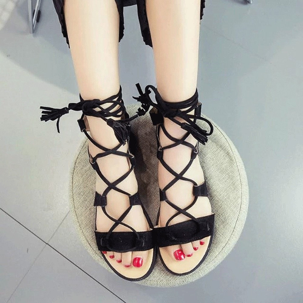 Clemonte cross tied fringe gladiator sandals