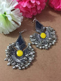 Silver earrings with black and yellow stone