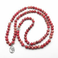 Om Charm 108 Natural Red Regalite Mala