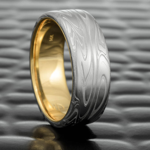 Damascus Steel 7mm Flat Band with 14k Yellow Gold Liner  |  SWIRLING CURRENT
