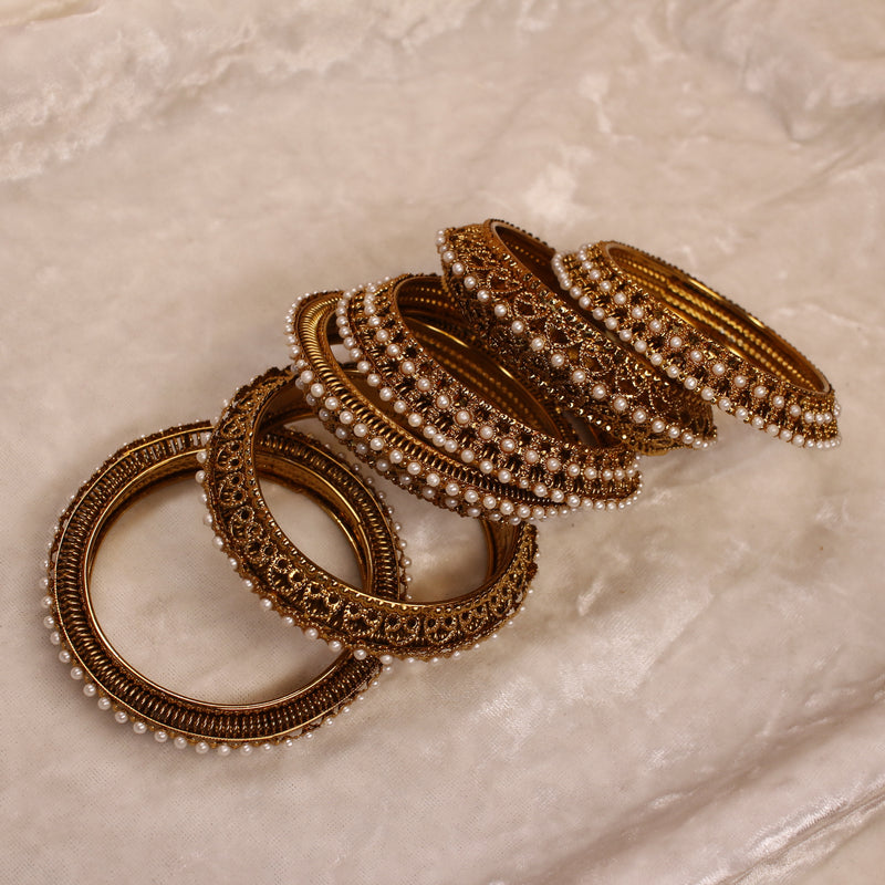 Pearl edged Bangles.