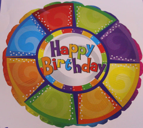 A bright colored pool ring mylar balloon with happy birthday written in the center of it.