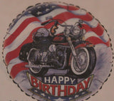 A mylar balloon with a motorcycle, a flying american flag and happy birthday.