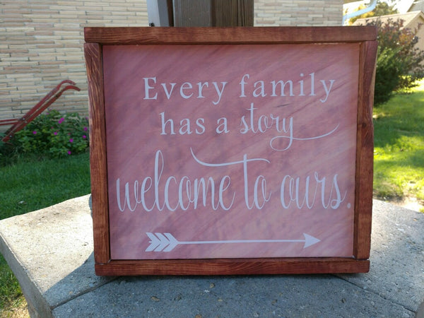 Every Family has a Story Welcome to Ours wooden sign