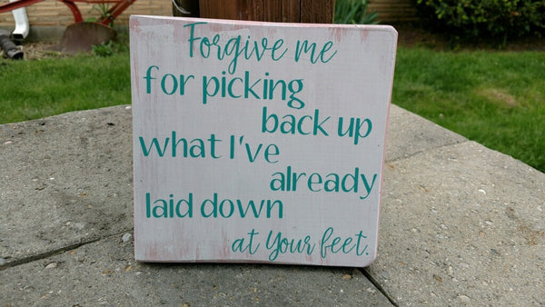 Forgive me for picking back up what i've already laid down at your feet.  wooden sign