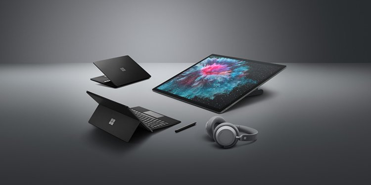 microsoft-surface-pro-6-surface-laptop-2-surface-studio-2-surface-headphones-hands