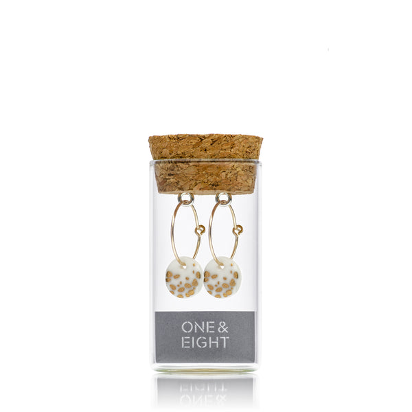 Gold haze earrings in reusable bottle