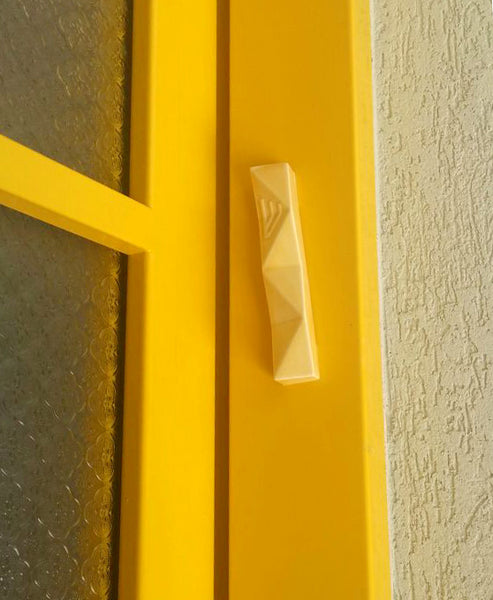 Yellow Mezuzah case, on a Yellow doorpost, daring and bright, a unique entrance to Ruthie's home in Mazkeret Batia