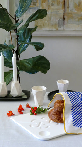 modern Shabbat table setting with contemporary Judaica - made in Israel