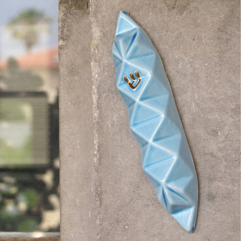 Origami Mezuzah case will fit your front door, and will make a stylish statement entrance to your home.