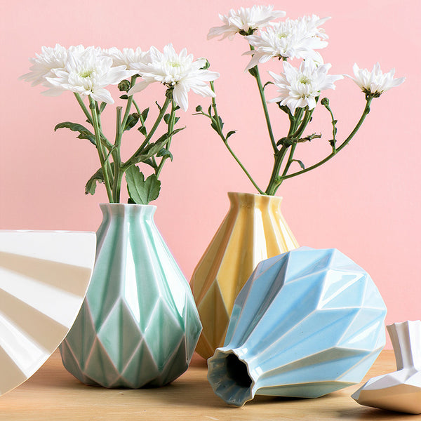 geometric vases in pastel colors with white flowers