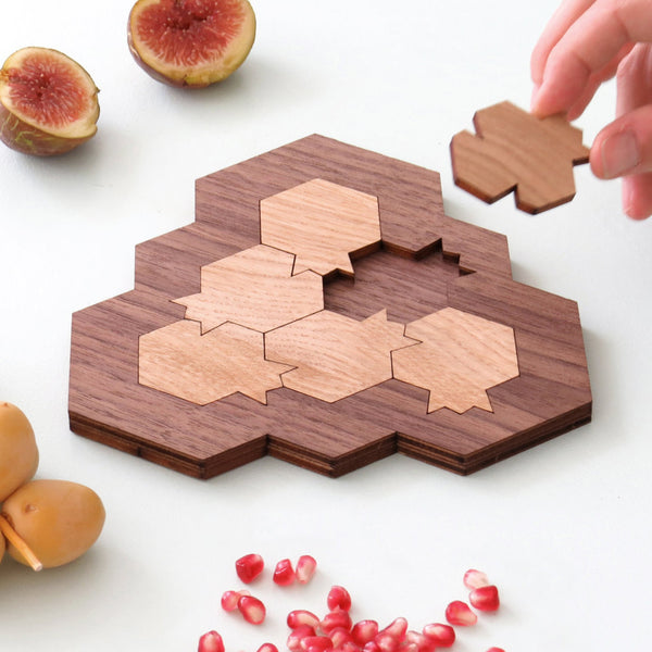 challenging wooden mind game, based on pomegranate and honeycomb shapes