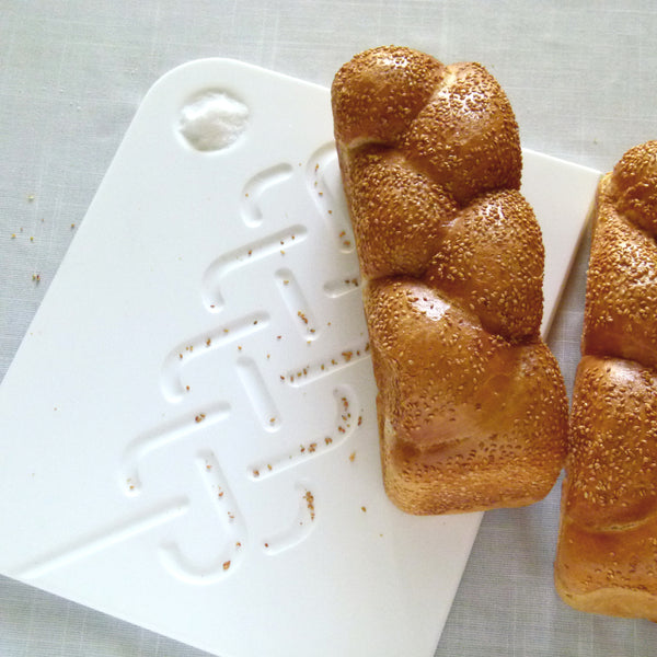 modern Challah board made of white corian
