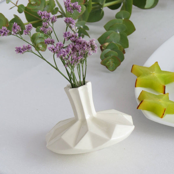 a spinning top and a flower vase - original Hanukkah decor