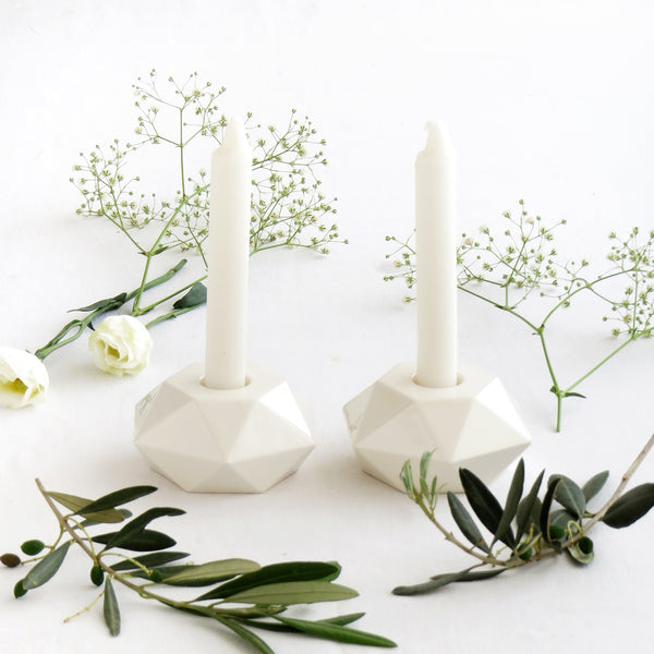 white minimalist shabbat candle holders