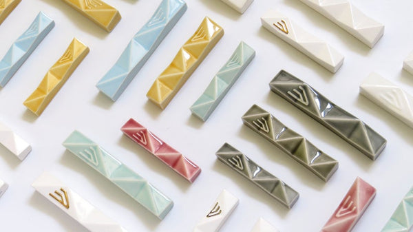 Modern geometric mezuzah cases by Armadillo judaica lovers