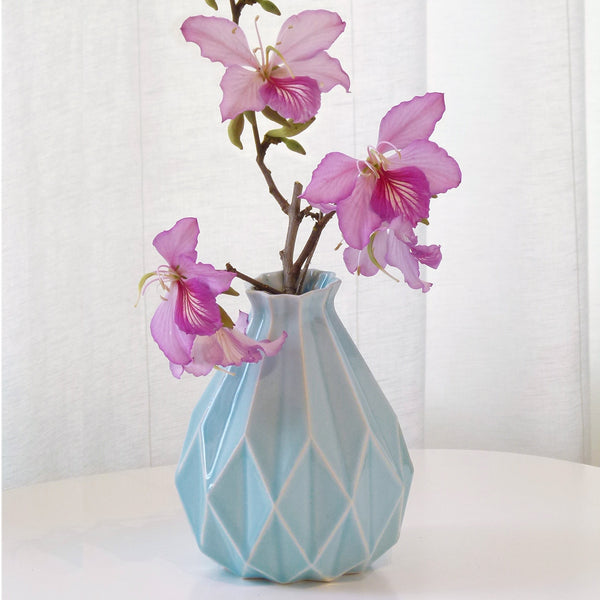 Light blue ceramic vase in geometric origami style