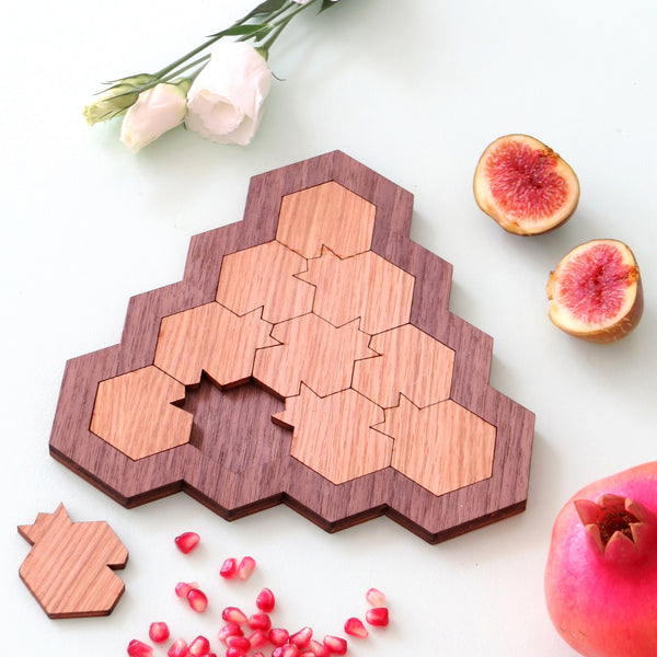 Wooden puzzle, with pomegranate shaped parts.