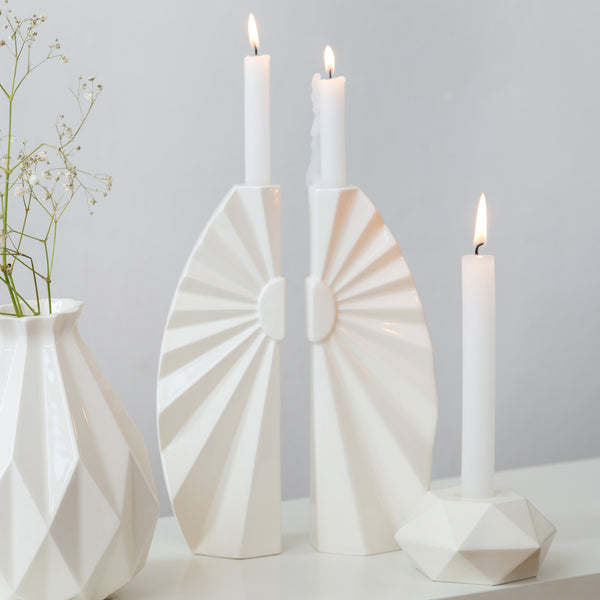 A pair of white modern candlesticks for Shabbat