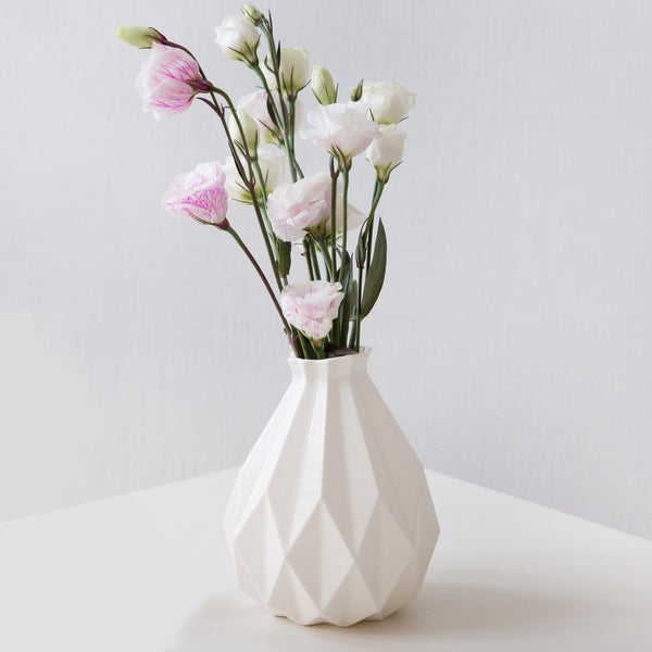 white ceramic vase in modern geometric style with pink flowers
