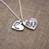 Descending duo of silver handprint heart charms necklace personalised