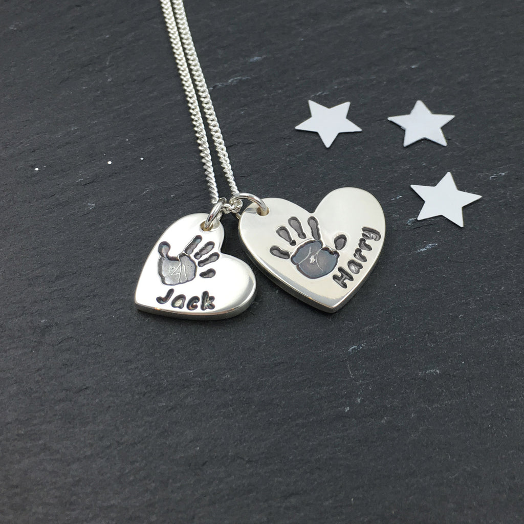 0423283d4 Descending duo of silver handprint heart charms necklace personalised
