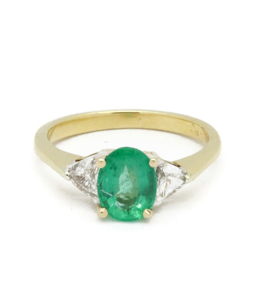 Diamond and Oval Shaped Emerald Ring