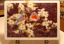 Bluebirds on Dogwood Tempered Glass Cutting Board and Hot Trivet