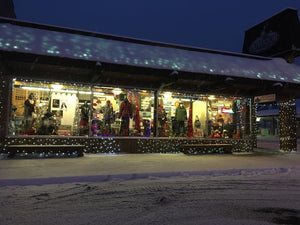 Outdoor Ventures - A Lure of Lights snow covered streets & store front view