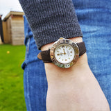 Wrist Shot of Ladies Vintage Dufont White Dial Watch with Brown Leather Strap