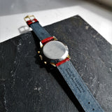 Rear of red leather crocodile strap on vintage chronograph watch
